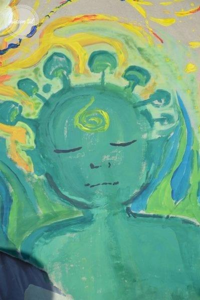 Spórolás zöld arc festve